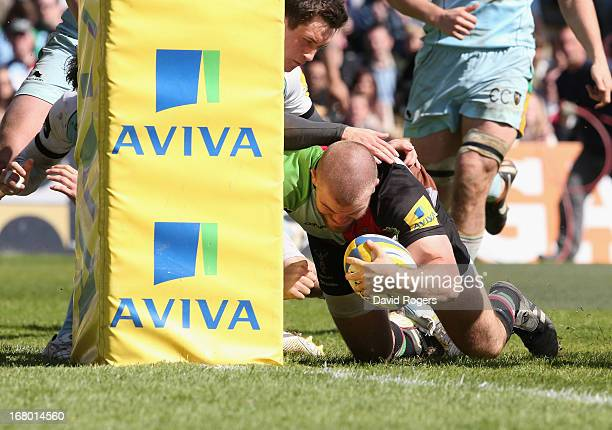 Rob Buchanan of Harlequins dives against the foot of the post to score a try during the Aviva Premiership match between Harlequins and Northampton...