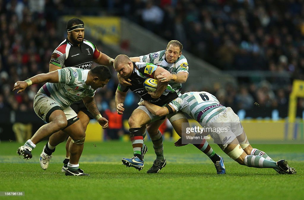 Rob Buchanan of Harlequins is tackled by David Paice and Declan Danaher (R) of London Irish during the Aviva Premiership match between Harlequins and London Irish at Twickenham Stadium on December 29, 2012 in London, England.