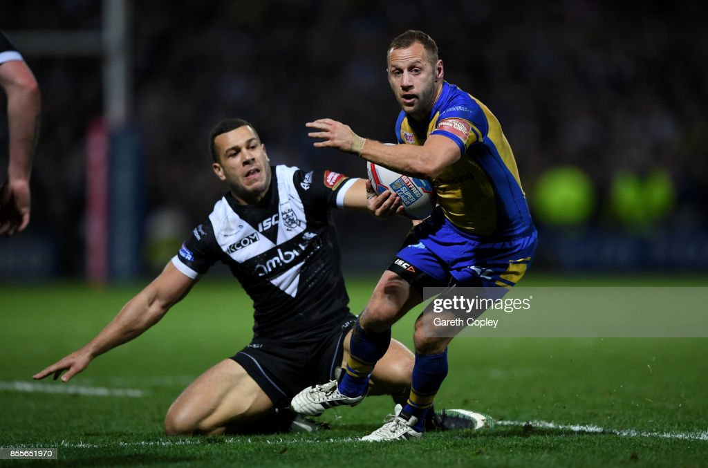 Rob Burrow of Leeds gets past Carlos Tuimavave of Hull FC during the Betfred Super League semi final between Leeds Rhinos and Hull FC at Headingley on September 29, 2017 in Leeds, England.