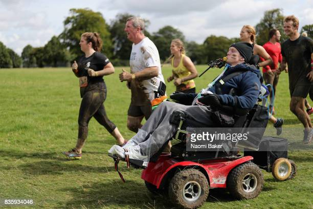 Rob Camm with his teammates during the 2017 Tough Mudder South West at Badminton Estate on August 20 2017 in Cirencester England