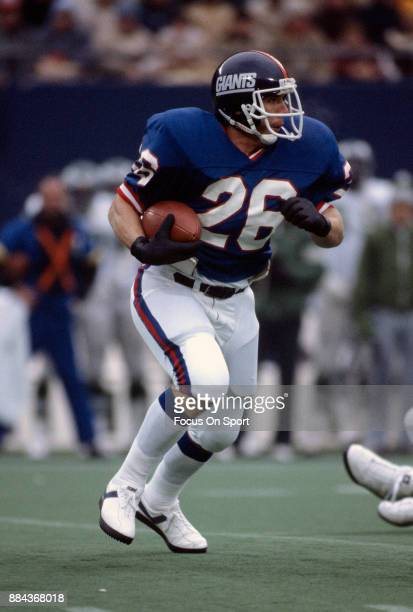 Rob Carpenter of the New York Giants carries the ball against the Philadelphia Eagles during an NFL game October 9 1983 at Giants Stadium in East...