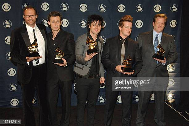 Rob Cavallo with Mike Dirnt Billie Joe Armstrong and Tre Cool of Green Day winner Record Of The Year for Boulevard Of Broken Dreams