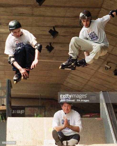 Rob Cole and Johnny SaoBento demonstrate their rollerblading skills by jumping over Sports minister Tony Banks at the Sony Playstation Skate Park...