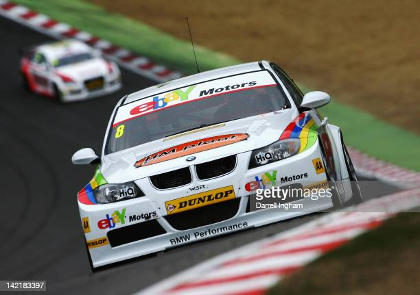 Rob Collard of Great Britain drives the ebay Motors BMW 320si during practice for the Dunlop MSA British Touring Car Championship race at the Brands...