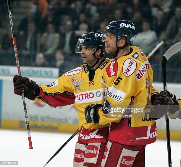 Rob Collins and Craig Johnson of Dusseldorf celebrate after Craig Johnson's first goal during the DEL Play Off semi final match between Sinupret Ice...
