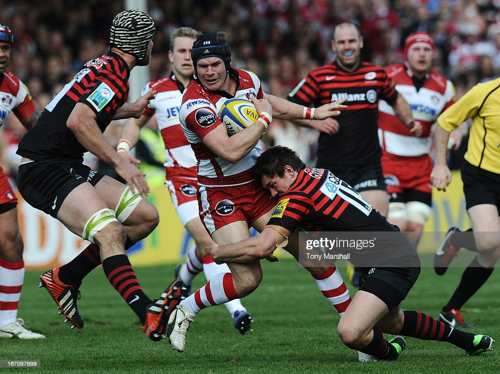 Rob Cook of Gloucester tackled by Alex Goode of Saracens during the Aviva Premiership match between Gloucester and Saracens at Kingsholm Stadium on April 20, 2013 in Gloucester, England.