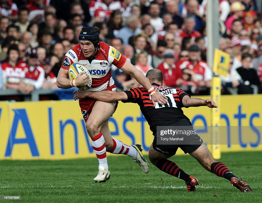Rob Cook of Gloucester tackled by Charlie Hodgson of Saracens during the Aviva Premiership match between Gloucester and Saracens at Kingsholm Stadium on April 20, 2013 in Gloucester, England.