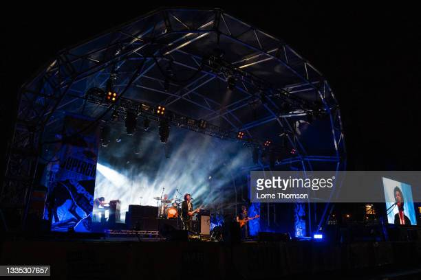 Rob Coombes, Danny Goffey, Gaz Coombes and Mick Quinn of Supergrass perform at South Facing Festival on August 20, 2021 in London, England.