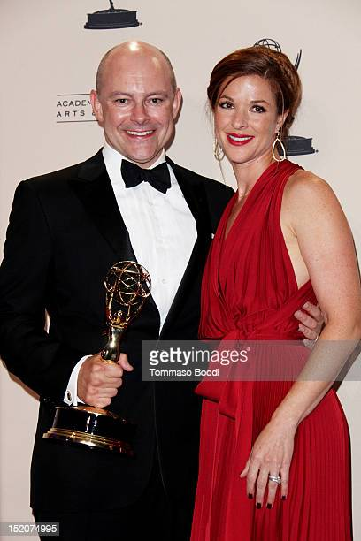 Rob Corddry and Sandra Corddry pose in the press room at the 2012 Primetime Creative Arts Emmy Awards held at the Nokia Theatre LA Live on September...