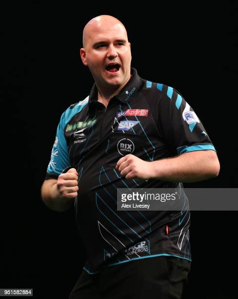 Rob Cross celebrates during his match against Raymond van Barneveld in the 2018 Unibet Premier League at The Manchester Arena on April 26 2018 in...