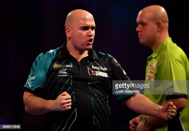 Rob Cross celebrates during his Semi Final Match against Michael van Gerwen during the 2018 William Hill PDC World Darts Championships at Alexandra...