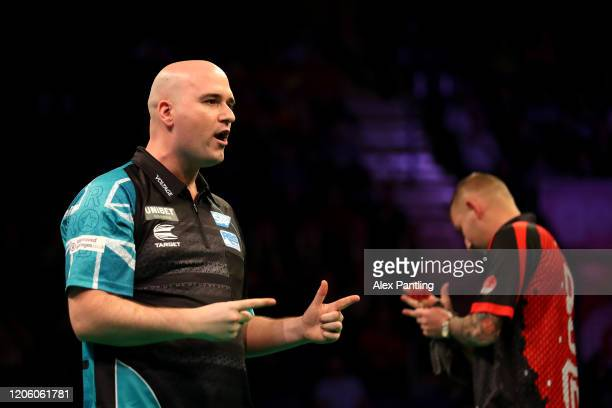 Rob Cross celebrates in his match against Nathan Aspinall during day two of the Unibet Premier League at Motorpoint Arena on February 13 2020 in...