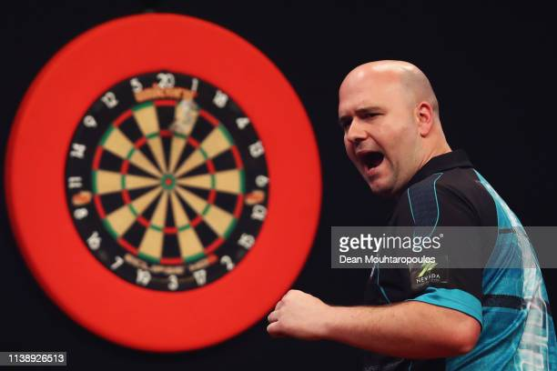 Rob Cross of England celebrates as he competes against Jeffrey de Zwaan of the Netherlands during day two of the 2019 Unibet Premier League Darts on...