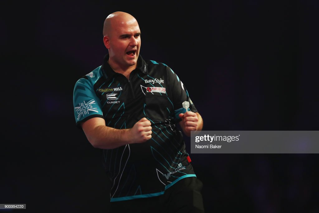 Rob Cross of England celebrates winning a set during the final match against Phil Taylor of England on Day Fifteen at the 2018 William Hill PDC World Darts Championships at Alexandra Palace on January 1, 2018 in London, England.