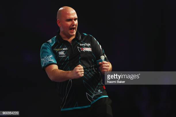 Rob Cross of England celebrates winning a set during the final match against Phil Taylor of England on Day Fifteen at the 2018 William Hill PDC World...