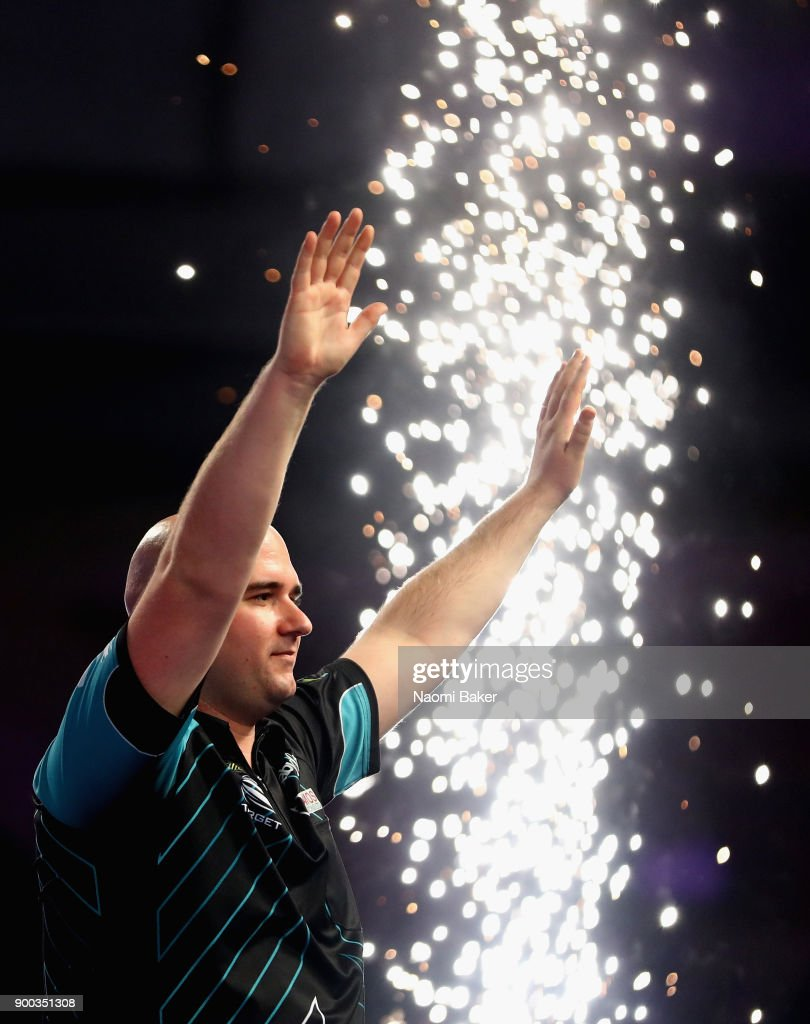 Rob Cross of England celebrates winning the PDC World Darts Championship final against Phil Taylor of England on Day Fifteen at the 2018 William Hill PDC World Darts Championships at Alexandra Palace on January 1, 2018 in London, England.