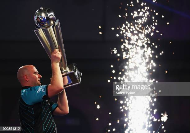 Rob Cross of England celebrates winning the PDC World Darts Championship final against Phil Taylor of England on Day Fifteen at the 2018 William Hill...