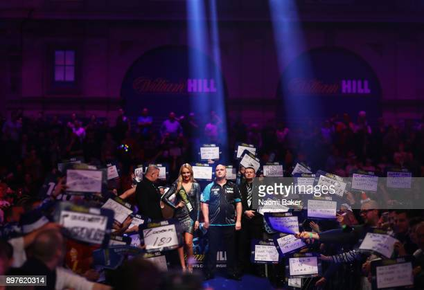 Rob Cross of England waits to walk onto the stage prior to the secod round match against Michael Smith of England on day ten of the 2018 William Hill...