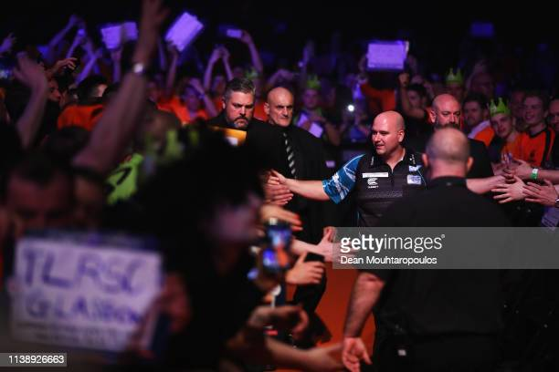 Rob Cross of England walks out before he competes against Jeffrey de Zwaan of the Netherlands during day two of the 2019 Unibet Premier League Darts...