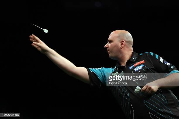 Rob Cross of Great Britain throws against Michael van Gerwen of The Netherlands in their semifinal at the Betway Premier League Darts PlayOffs at The...