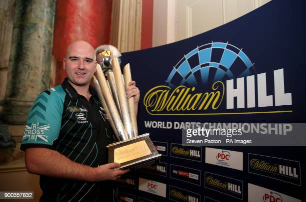 Rob Cross poses with the trophy during day fifteen of the William Hill World Darts Championship at Alexandra Palace London