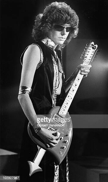 Rob Davis from Mud performs live on stage at Hilversum in Holland in 1974