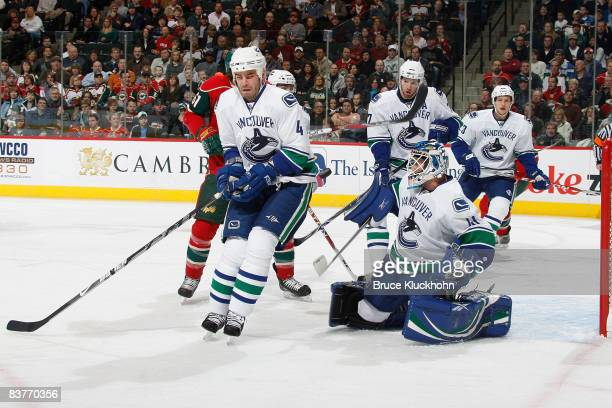 Rob Davison of the Vancouver Canucks takes a slap shot to the stomach defending his against the Minnesota Wild during the game at the Xcel Energy...