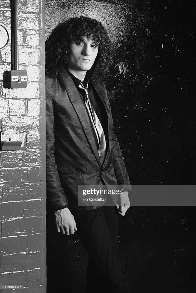 Rob Dean, guitarist with New Wave band Japan, poses beside a