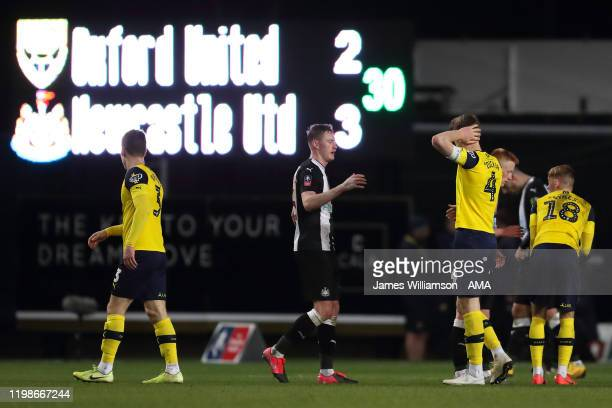 Rob Dickie of Oxford United and teammates dejected at full time of the FA Cup Fourth Round Replay match between Oxford United and Newcastle United at...