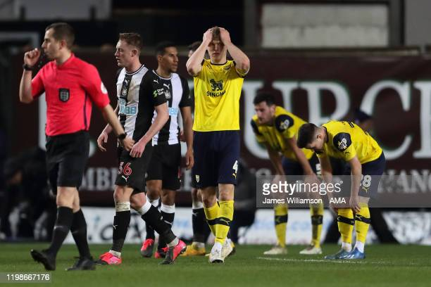 Rob Dickie of Oxford United dejected at full time of the FA Cup Fourth Round Replay match between Oxford United and Newcastle United at Kassam...