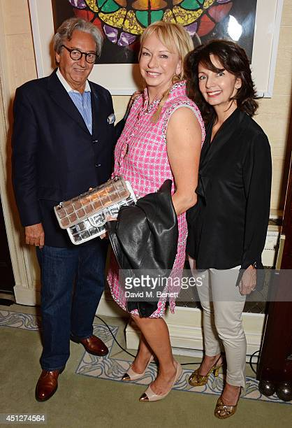 Rob Dickins Judy Craymer and Cherry Gillespie attend a drinks reception hosted by The House Of Britannia to celebrate their new joint venture with...