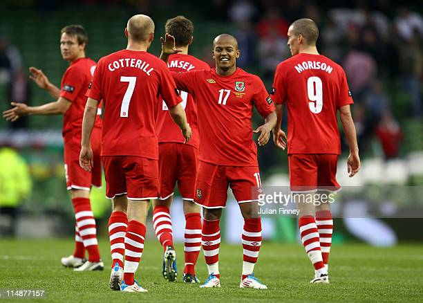 Rob Earnshaw of Wales celebrates scoring the second goal with team mates during the Carling Nations Cup match between Northern Ireland and Wales at...