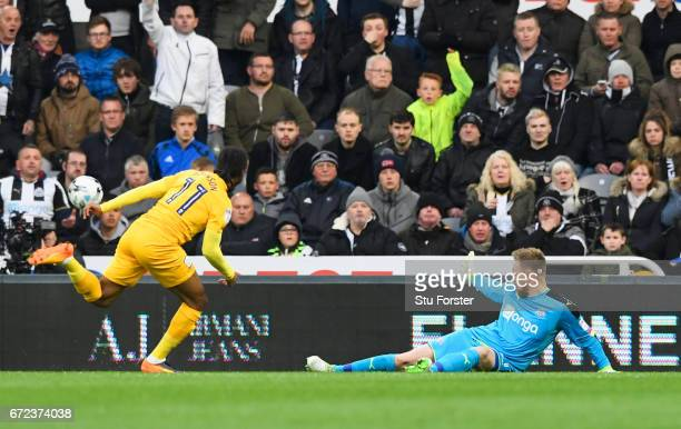 Rob Elliot of Newcastle United makes a save from Daniel Johnson of Preston North End during the Sky Bet Championship match between Newcastle United...