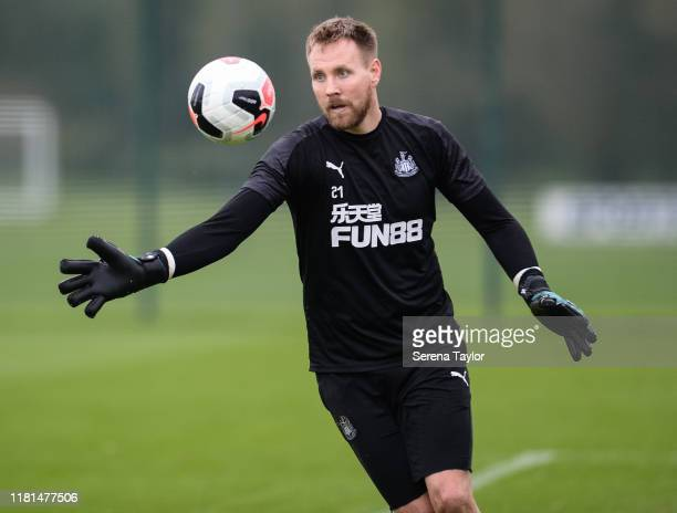 Rob Elliot throws the ball into the air to kick into play during the Newcastle United Training Session at the Newcastle United Training Centre on...