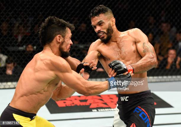 Rob Font punches Douglas Silva de Andrade of Brazil in their bantamweight bout during the UFC 213 event at TMobile Arena on July 8 2017 in Las Vegas...