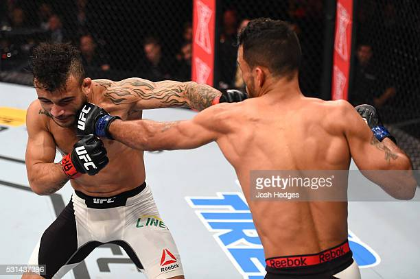 Rob Font punches John Lineker of Brazil in their bantamweight bout during the UFC 198 event at Arena da Baixada stadium on May 14 2016 in Curitiba...