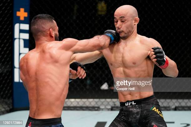 Rob Font punches Marlon Moraes of Brazil in a bantamweight fight during the UFC Fight Night event at UFC APEX on December 19, 2020 in Las Vegas,...