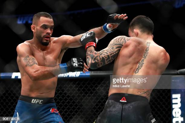 Rob Font throws a punch against Thomas Almeida in their Bantamweight fight during UFC 220 at TD Garden on January 20 2018 in Boston Massachusetts