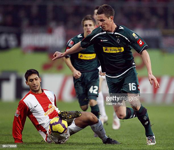 Rob Friend of Moenchengladbach and Malik Fathi of Mainz battle for the ball during the Bundesliga match between FSV Mainz 05 and Borussia...