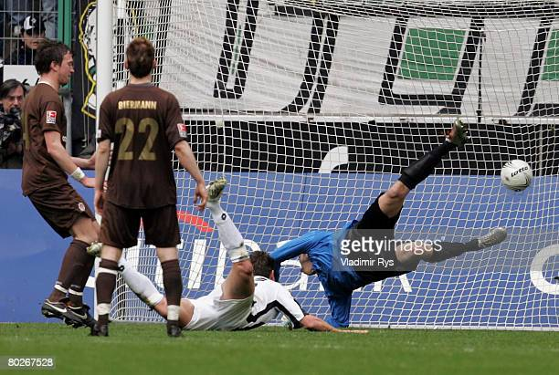 Rob Friend of Moenchengladbach scores the 1:0 goal against Patrik Borger of Pauli during the Second Bundesliga match between Borussia...