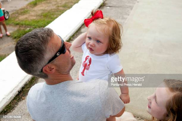 Rob Galkowski of Owls Head picked up his daughter Norah 9 months after she participated in the diaper derby at the Maine Lobster Festival in Rockland...