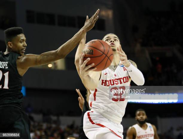 Rob Gray of the Houston Cougars scores the gamewinning basket with 1 second left in the game against the San Diego State Aztecs during the second...