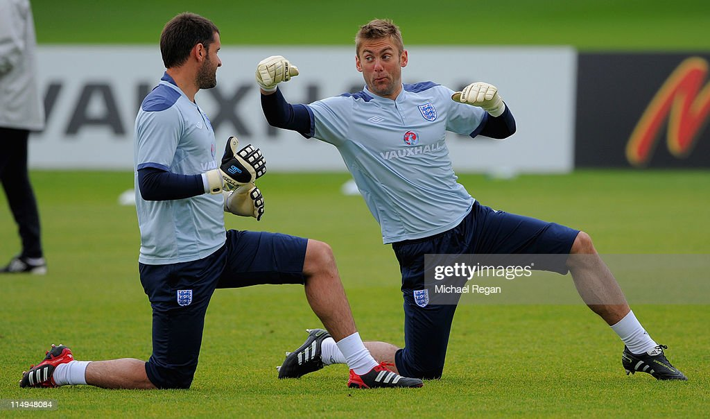 Rob Green jokes as he pretends to punch Scott Carson during the England training session at London Colney on May 31, 2011 in St Albans, England.