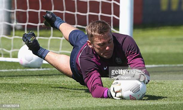 Rob Green saves during the England training session held at St Georges Park on June 4 2015 in BurtonuponTrent England