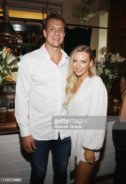 Rob Gronkowski and Camille Kostek attend the Sports Illustrated Swimsuit 2019 Issue Launch at Seaspice on May 10 2019 in Miami Florida