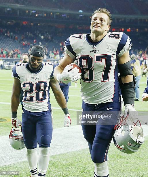 Rob Gronkowski and Darryl Roberts of the New England Patriots walk off the field after the Patriots defeated the Houston Texans 276 at NRG Stadium on...