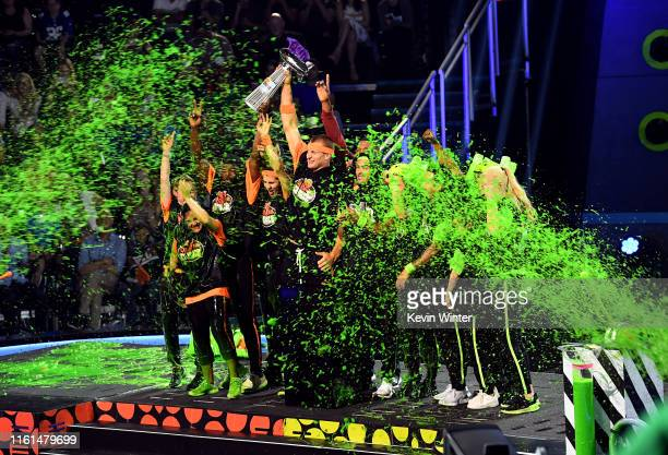 Rob Gronkowski and fellow participants are slimed after a challenge onstage during Nickelodeon Kids' Choice Sports 2019 at Barker Hangar on July 11...