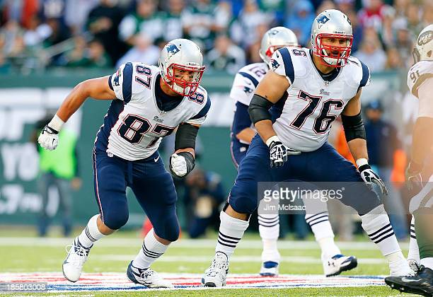 Rob Gronkowski and Sebastian Vollmer of the New England Patriots in action against the New York Jets on October 20 2013 at MetLife Stadium in East...