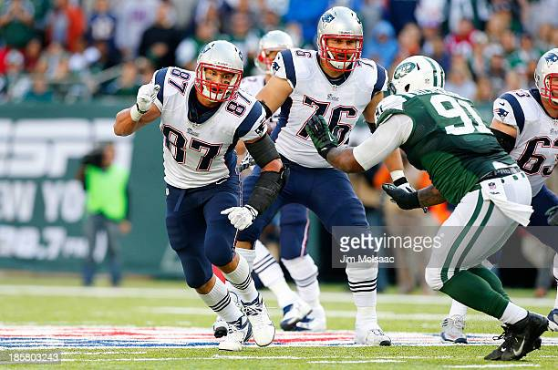 Rob Gronkowski and Sebastian Vollmer of the New England Patriots in action against Sheldon Richardson of the New York Jets on October 20 2013 at...