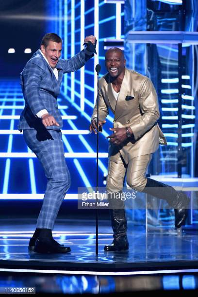 Rob Gronkowski and Terry Crews speak onstage during the 2019 Billboard Music Awards at MGM Grand Garden Arena on May 1 2019 in Las Vegas Nevada